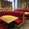 Tufted red leather booths at Duke University.